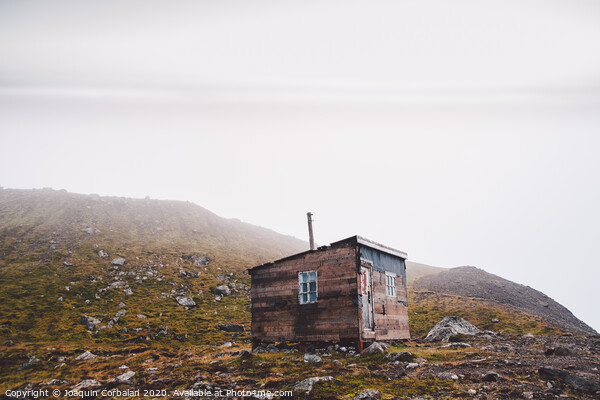 Small wooden hut on top of a mountain surrounded by fog in winter to seek solitude. Acrylic by Joaquin Corbalan