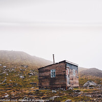 Buy canvas prints of Small wooden hut on top of a mountain surrounded by fog in winter to seek solitude. by Joaquin Corbalan
