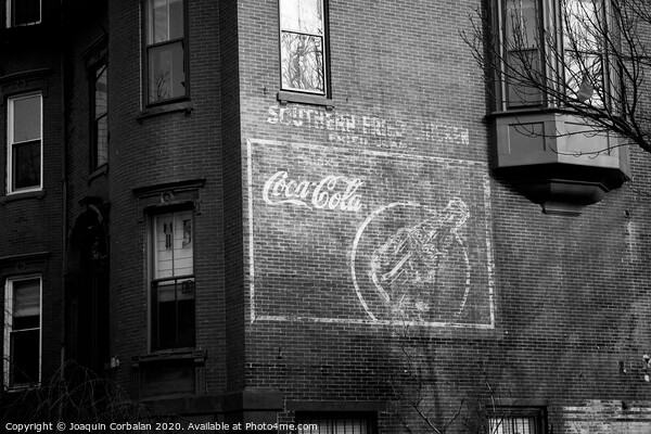 Old advertising poster of soda drink on the brick walls of a building. Print by Joaquin Corbalan