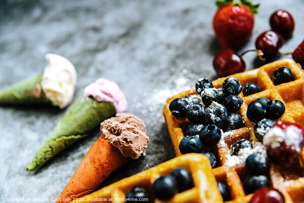 Ice creams and waffles with tasty red fruits full of healthy vitamins, over dark stone background with copy space for text. Acrylic by Joaquin Corbalan