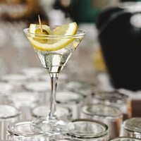 Buy canvas prints of Cup of gin and tonic, with a slice of lemon and olive. by Joaquin Corbalan