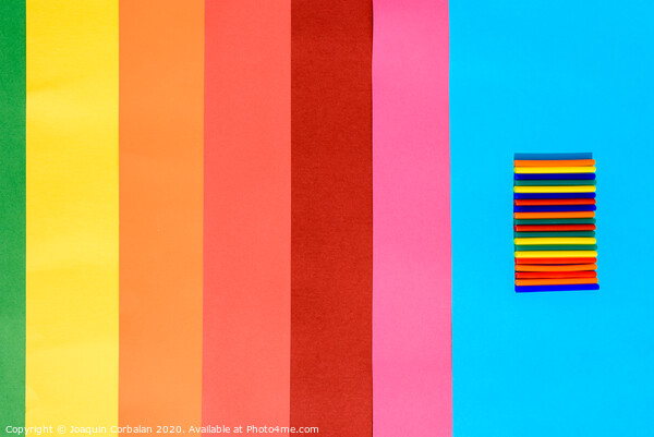 Colorful background of plastic bars, silicone glue, on a background of colored lines. Framed Print by Joaquin Corbalan
