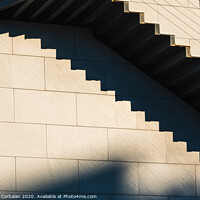 Buy canvas prints of Minimalist wall with shadows from the upper steps of a modern stone staircase. by Joaquin Corbalan