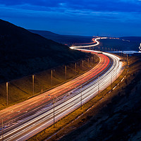 Buy canvas prints of M62 light trails across the Penines in West Yorksh by Katie McGuinness