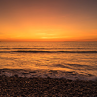 Buy canvas prints of Waves on the sunset lit shoreline at Westward Ho by Tony Twyman