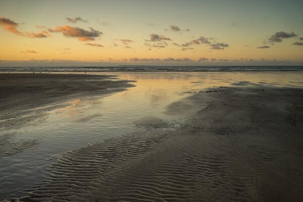 Sunset reflections at Westward Ho! Canvas Print by Tony Twyman