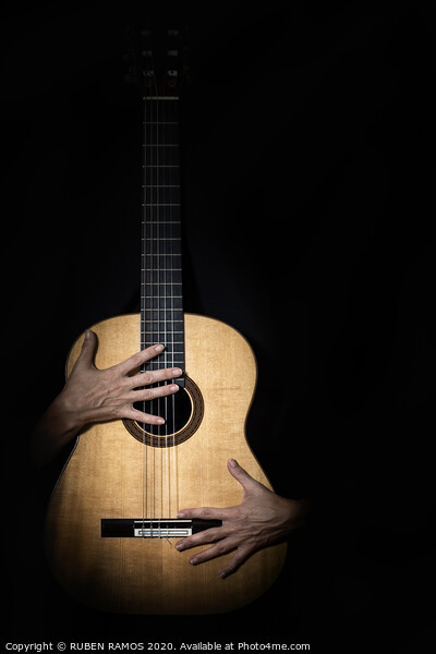 Female hands on guitar. Canvas Print by RUBEN RAMOS