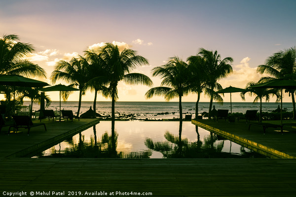 Infinity pool at resort in Mauritius during sunset Canvas Print by Mehul Patel