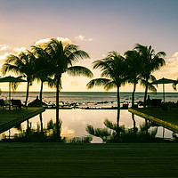 Buy canvas prints of Infinity pool at resort in Mauritius during sunset by Mehul Patel