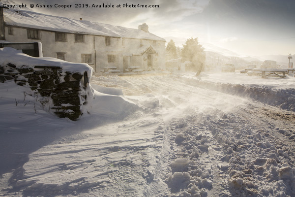 The Kirkstone Pass Inn, plastered in fresh snow  Canvas print by Ashley Cooper