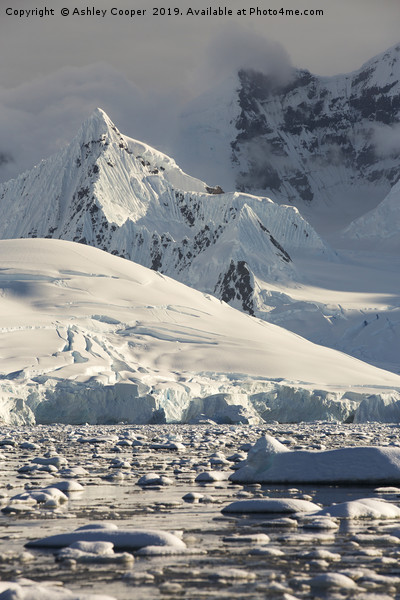 Antarctic spire. Canvas Print by Ashley Cooper