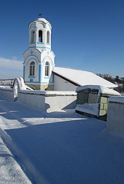 Village church in the snow Canvas print by Martin Smith