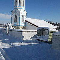 Buy canvas prints of Village church in the snow by Martin Smith