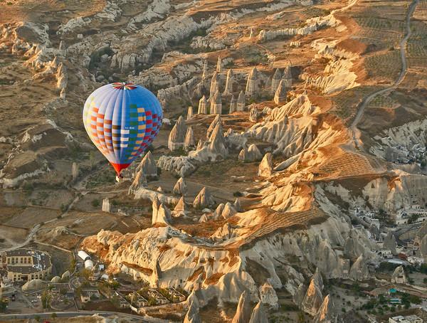 Sunrise Balloon Ascent Over Cappadocia Print by Ian Homewood