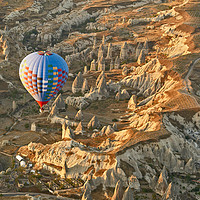 Buy canvas prints of Sunrise Balloon Ascent Over Cappadocia by Ian Homewood