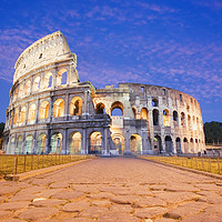 Buy canvas prints of The Colosseum illuminated at dusk rome italy by paul hardy