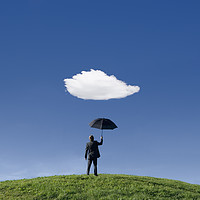 Buy canvas prints of Businessman on a hill holding umbrella  by conceptual images