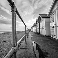 Buy canvas prints of Row of beach huts on Cromer promenade by Chris Yaxley