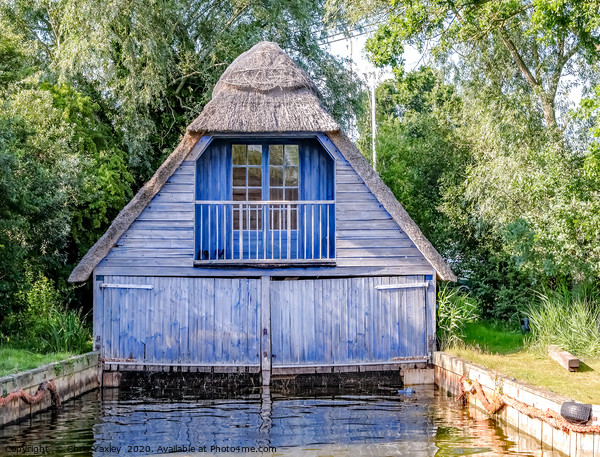 Wooden boat shed on the Norfolk Broads Canvas Print by Chris Yaxley