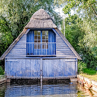 Buy canvas prints of Wooden boat shed on the Norfolk Broads by Chris Yaxley