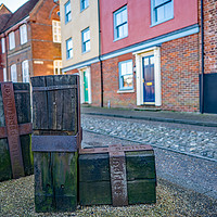Buy canvas prints of Wooden statues along Quayside, Norwich by Chris Yaxley