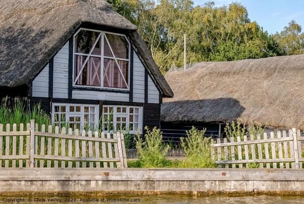 Traditional riverside cottage with thatched roof Canvas Print by Chris Yaxley