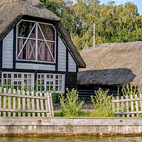 Buy canvas prints of Traditional riverside cottage with thatched roof by Chris Yaxley