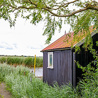 Buy canvas prints of Wooden let on the waterfront of the River Bure by Chris Yaxley