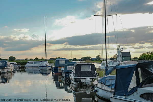 Boats moored up in Thurne Dyke Canvas Print by Chris Yaxley