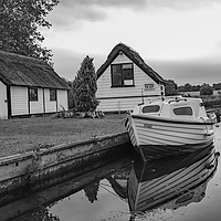 Buy canvas prints of Boat and boat house on the River Bure by Chris Yaxley