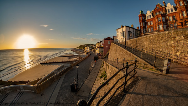 Sunrise over the sea in the coastal town of Cromer Canvas Print by Chris Yaxley