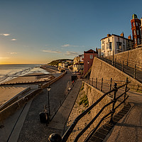 Buy canvas prints of Sunrise over the sea in the coastal town of Cromer by Chris Yaxley