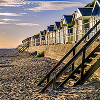 Buy canvas prints of Cromer beach huts at sunrise by Chris Yaxley