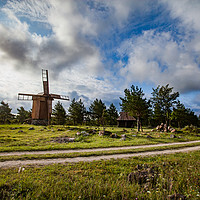 Buy canvas prints of Wooden windmill and rural road. by Alexey Rezvykh
