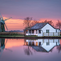 Buy canvas prints of Dawn reflections on the Norfolk Broads by David Powley