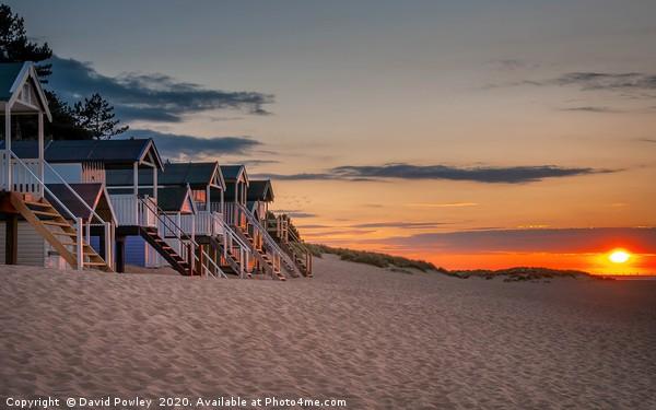 Wells-next-the-sea Beach hut sunset Framed Mounted Print by David Powley