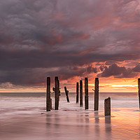 Buy canvas prints of Dawn colours over Happisburgh Beach by David Powley