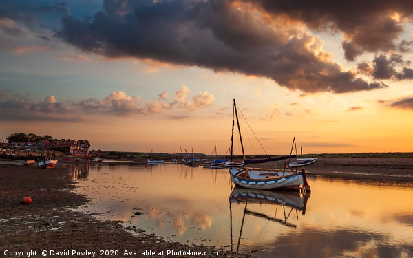 Evening glow at Burnham Overy Staithe Canvas Print by David Powley