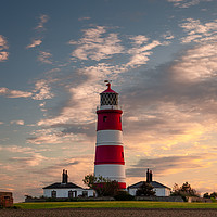 Buy canvas prints of Evening light over Happisburgh Lighthouse by David Powley