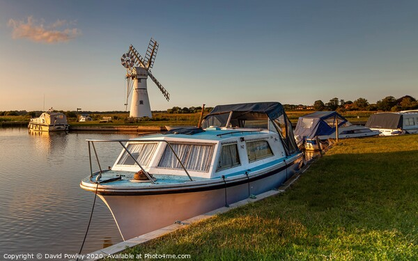 Evening light over Thurne Mill Canvas Print by David Powley