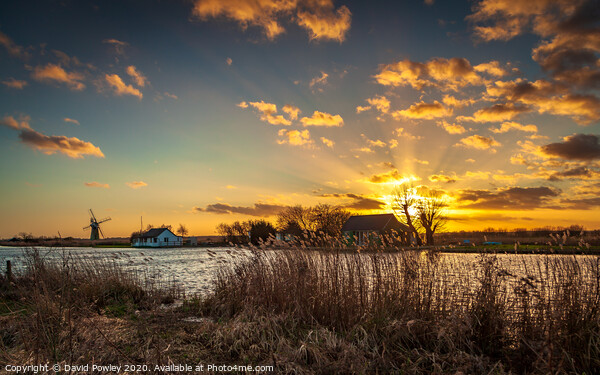 Thurne winter sunset Canvas Print by David Powley