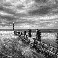 Buy canvas prints of Evening light on Cromer beach Mono by David Powley