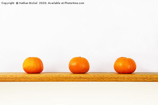 Three Oranges on a Shelf Framed Mounted Print by Nathan Bickel
