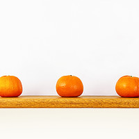 Buy canvas prints of Three Oranges on a Shelf by Nathan Bickel