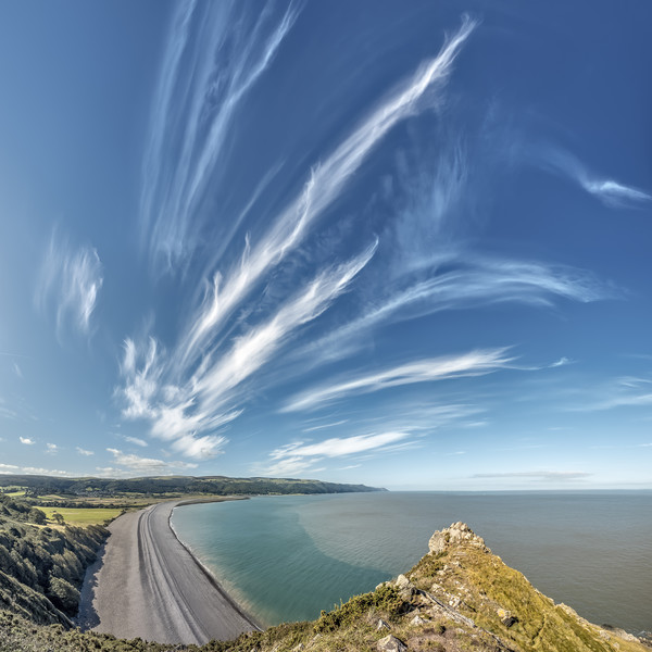 Cirrus clouds over Bossington Beach Canvas Print by Shaun Davey