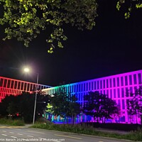 Buy canvas prints of Rainbow-style Illuminated Building  by Martin Baroch