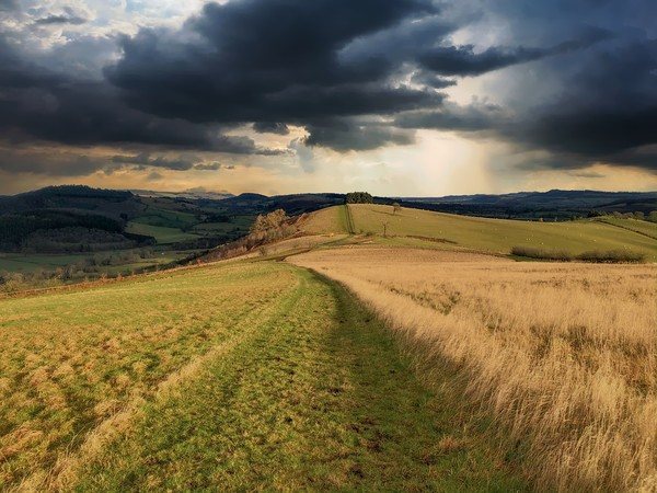A storm is brewing, South Shropshire Canvas Print by Simon Marlow