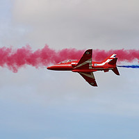 Buy canvas prints of Red Arrows through blue and red smoke by Simon Marlow