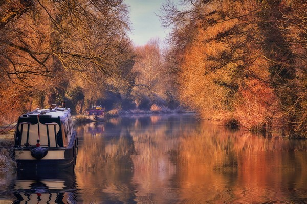 Autumn reflections on the Kennet and Avon Canal Canvas Print by Simon Marlow