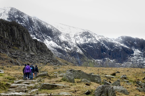 Hiking at Llyn Idwal in Snowdonia National Park, Wales Framed Mounted Print by Simon Marlow